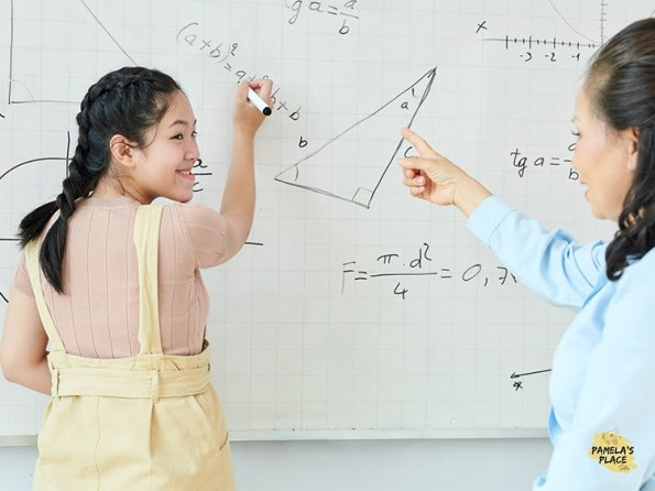 girl learning o level math from teacher