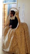 bearded man in gold elizabethan dress