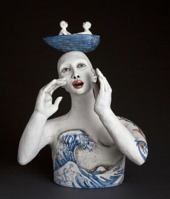 ceramic figure with boat on head
