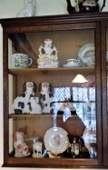 Staffordshire dogs, flat back, cow creamer, earthenware jug, and other pottery, Rufford