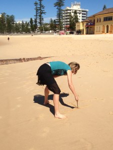 Watch out, world! I just wrote my intention for E-Cubed in the sand at Manley Beach in Sydney, Australia.
