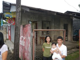 Ptr Rafael and Elsie Dominguez with son John Kyzel in front of their house back in 2012, before demolition of the front half.