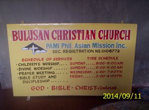 New Bulusan church signboard, printed on front and back, yet to mounted on a post.