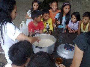 Sis Nida getting ready for kids milk feeding