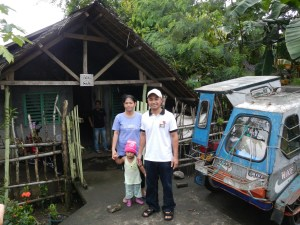 Pastor Redgie, Sister Aireen, and their daughter Aira Lois in front of their living quarters in Castilla (this is property donated by Mrs. Luz Ortega, used as the church until construction of the new church building about 1 km away a couple years ago funded by Korean Christians).
