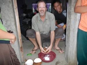 Ben making shredded coconut