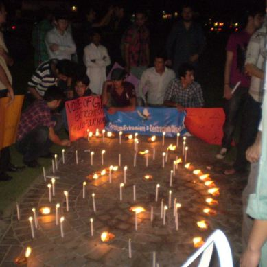 Lahore: GB students hold candle light vigil for victims, condemn violence and hatred