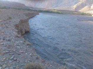 Photograph showing massive erosion of riverbank in Passu. Photo Courtesy: Shah Wali