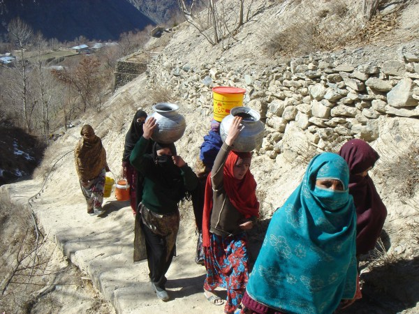 Women carrying water to their houses