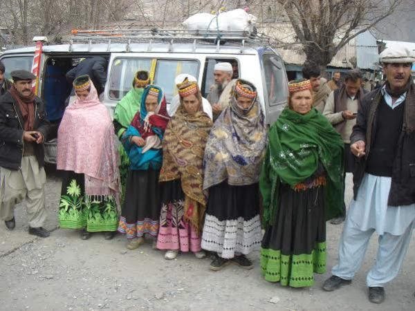 A group of Kalashi women and men talking to the media