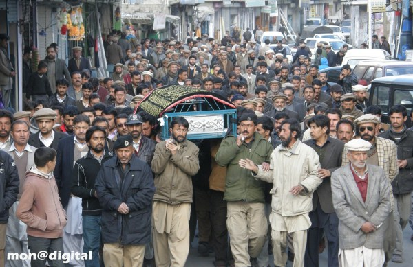 A procession carrying the body of Saeed Hassan for burial. Photo: Mon Digital