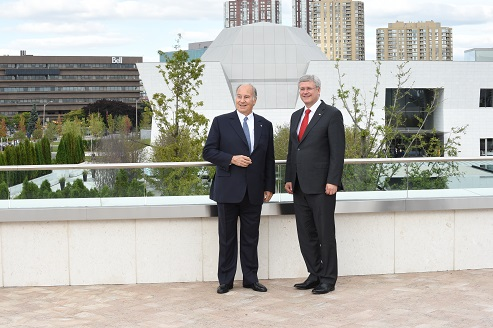 His Highness the Aga Khan and Prime Minister Harper on the terrace of the Ismaili Centre with the new Aga Khan Museum in the background - AKDN Gary Otte
