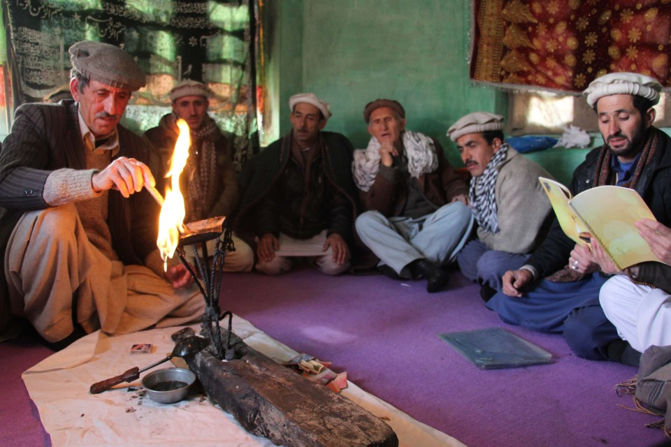 The ritual of Chiragh Roshan is being performed. The lamp is lit and the people recite Salwat