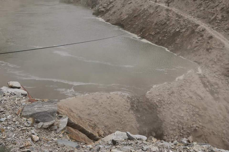 The river starts flowing over the landslide debris