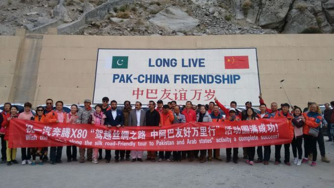 Rally participants pose with the leaders and officials near the Attabad Tunnels