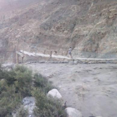 Shimshal River Flood: Bridge destroyed, road damaged, cultivable land affected at several places