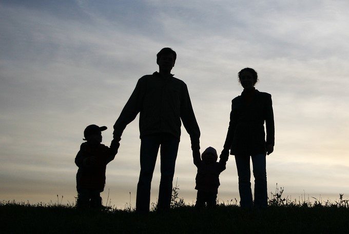 Silhouette of family of four outside
