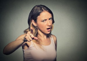 Lady not happy pointing her figure at someone