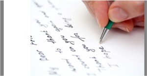 hand writing a note