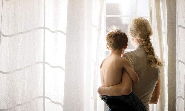 mom-holding-son-looking-out-window-photo-by-Sarah-Wilkerson1-840x559