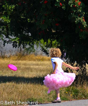 Pink tutu and frizbee