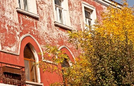 Beautiful building and yellow tree in Armenia