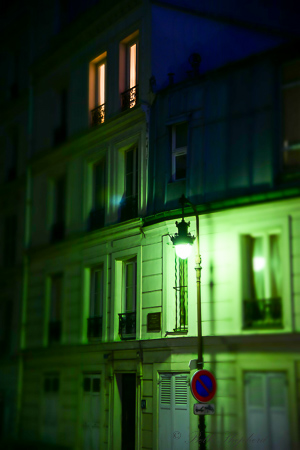 Green Paris building at night