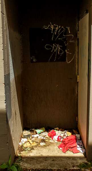 HILLSBORO TRIBUNE PHOTO: TRAVIS LOOSE - An alleyway in downtown Hillsboro shows signs of use as a toilet and trash can. Alcoves and doorways, such as this, were in part the genesis for an April Hillsboro Neighborhoods Coalition meeting to address a perceived increase in panhandling, homeless camping and camping debris. Cleanup of this area is the business owners responsibility.