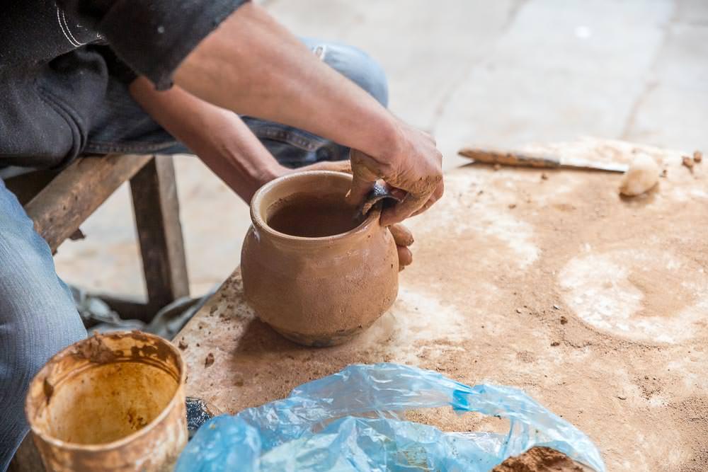 Creating a clay pot.
