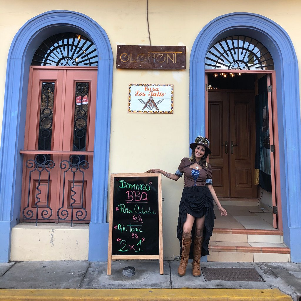 Residents stand outside Element bar inviting walkers through Casco Viejo