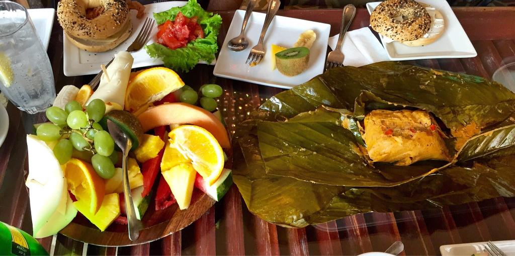 Breakfast with fruits, bagels and tamales at Casa Sucre Coffeehouse