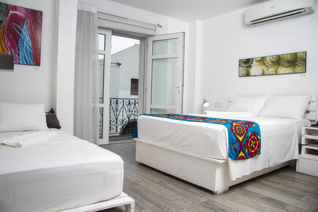 room with two beds and balcony at Gatto Blanco Party Hotel