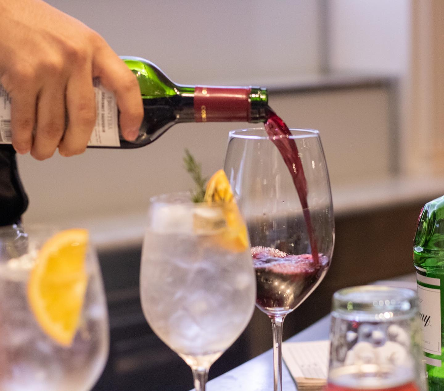 Serving wine in the MED restaurant of Villa Palma Boutique Hotel