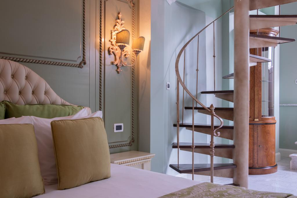 Executive rooms are very spacious with two floors connected by a spiral staircase and balcony in Villa Palma Boutique Hotel