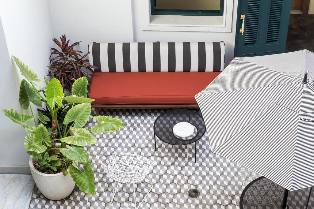 Internal courtyard with sofa, umbrella and plants at the American Trade Hotel in Casco Viejo