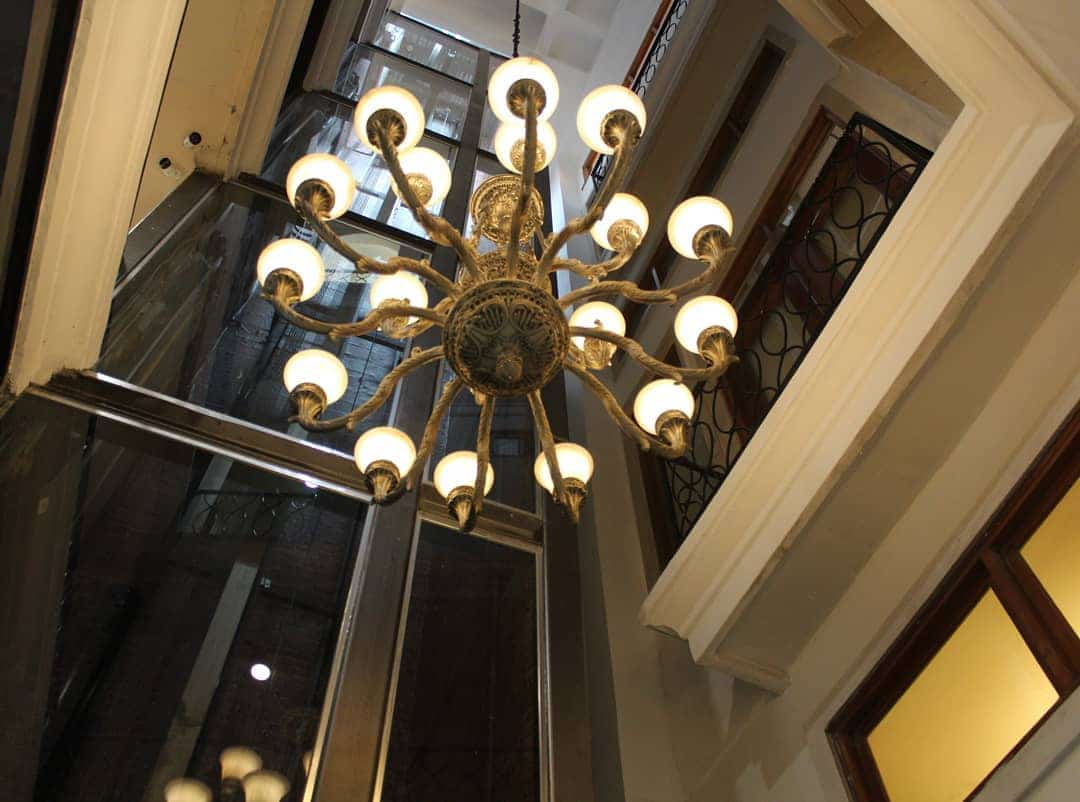 Chandelier and glass elevator at Casa Antigua Hotel