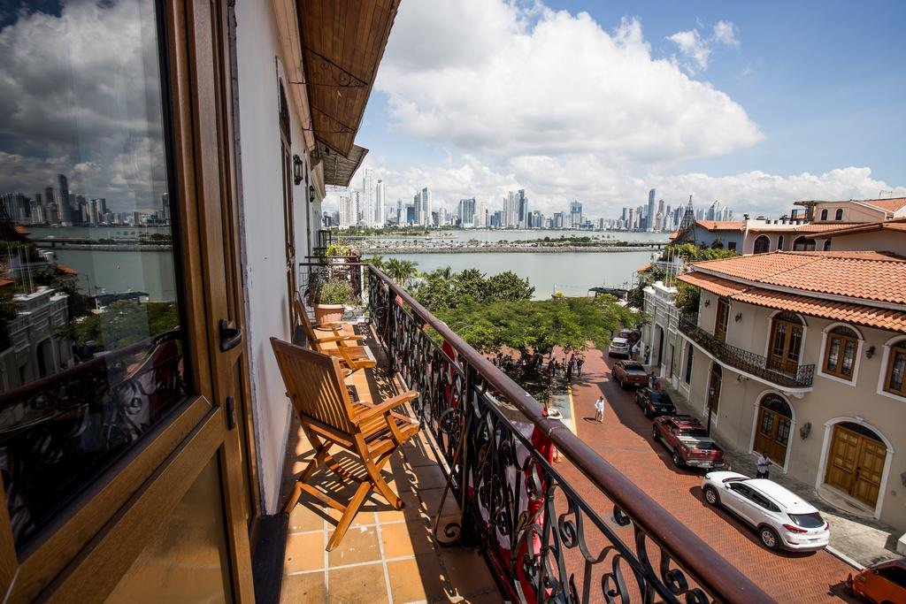 Balcony with chairs overlooking the skyline of Panama City at Casa Antigua Hotel