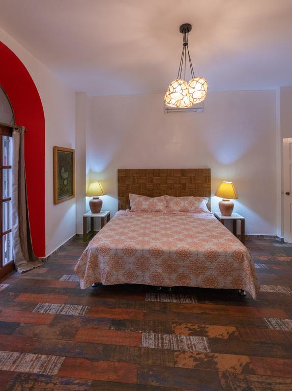 bedroom with king size bed in Charming Apartment in Casco Viejo