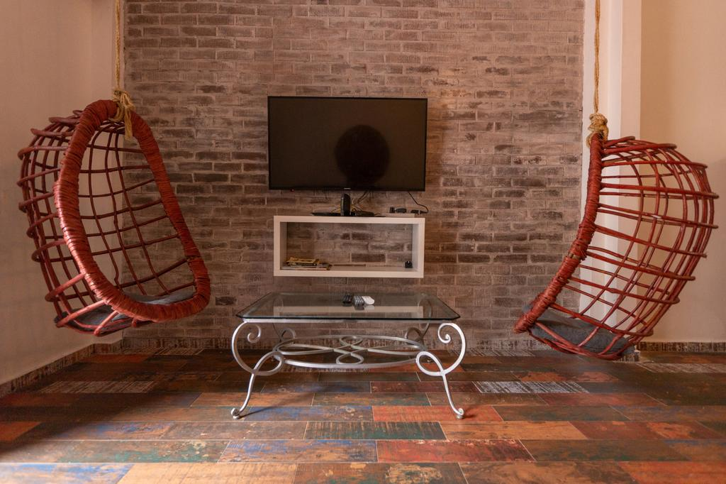 television with hanging chairs in Charming Apartment in Casco Viejo