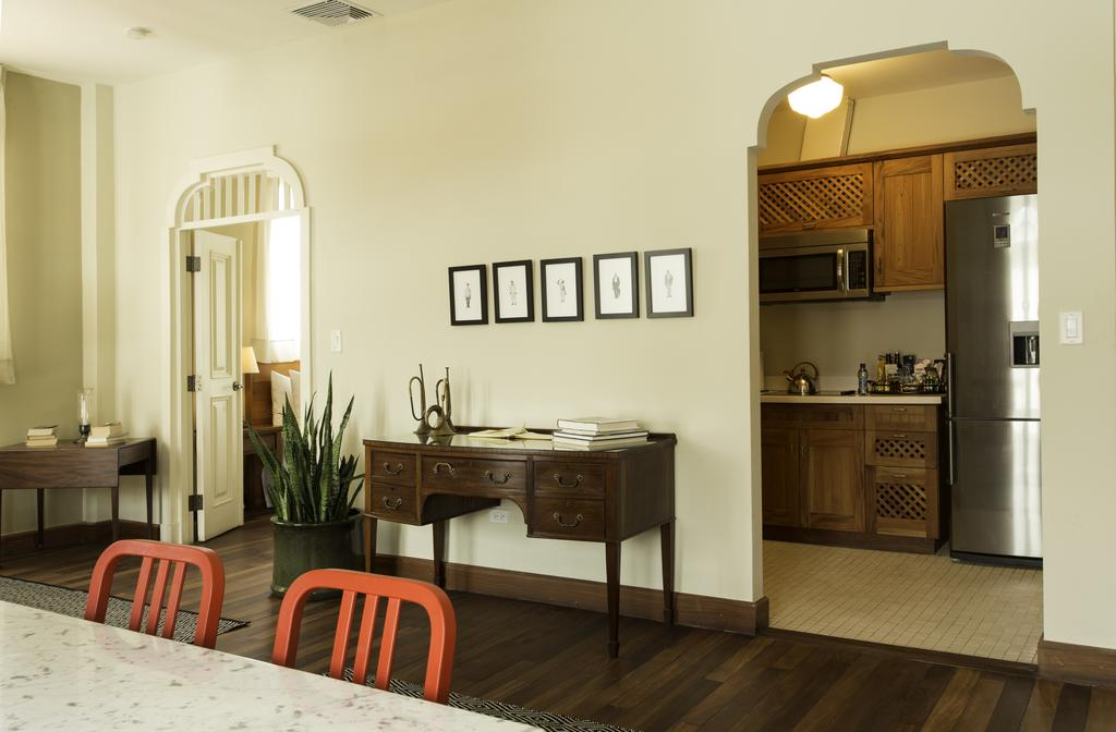 Dining and kitchen area of apartment of Las Clementinas Hotel