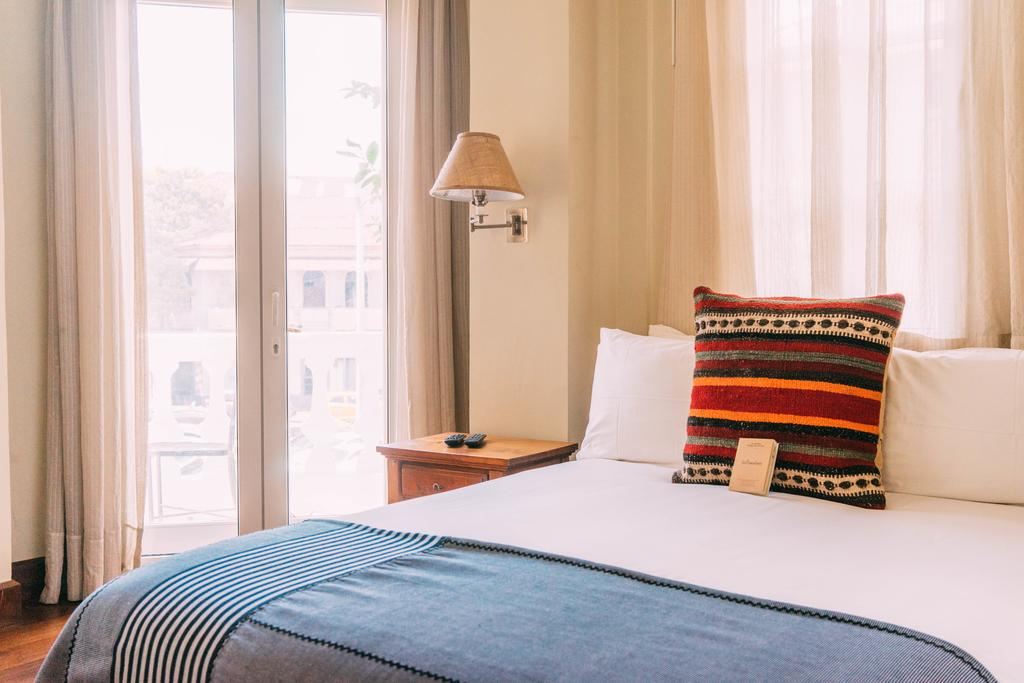 Bed in apartment of Las Clementinas Hotel