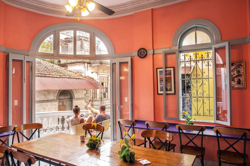 There is a full dining room with plenty of seats for guests and a balcony