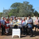 Chamber ambassadors gather to celebrate the grand opening of the Panama City Rescue Mission's Garden.