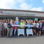 Chamber ambassadors gather to celebrate the grand opening of Beachy Beach Realty.