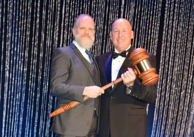 "2019 Chairman of the Board ""passes the gavel"" to 2020 Chairman of the Board, Andrew Rowell."