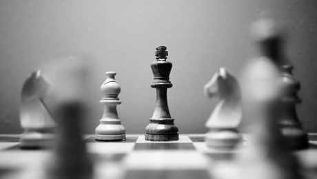 monochrome photo of wooden chess pieces