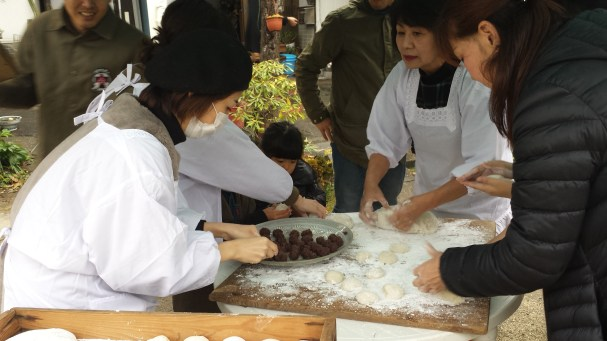 Kneading the mochi and putting red bean paste in them. Yummy