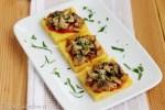 Crostini di polenta ai funghi e grana