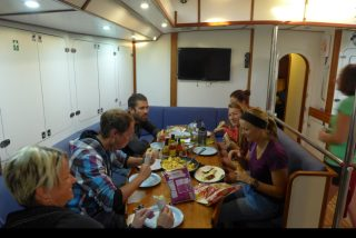 Breakfast aboard the Sea Dragon. Maddie, second from the front on the right.