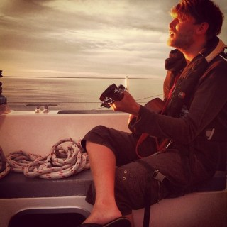 Maddie's photo of Andrew Murgatroyd jamming into the sunset.
